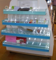 cosmetic display point of purchase store fixture makeup metal custom fabricated